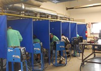 In the welding shop at our training center, we teach Mig, Tig, and stick welding plus grinding and finishing.